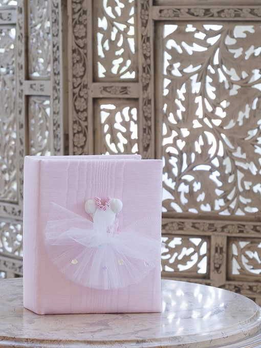 baby photo book with ballet tutu on pink moire