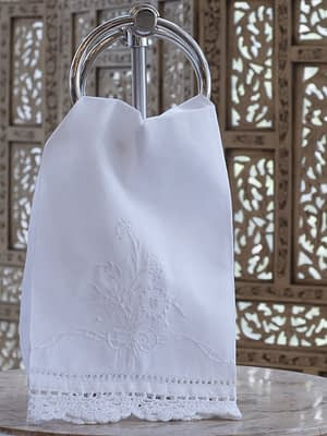 guest towel with embroidered flowers bow hem stitching and lace on linen blend