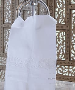 guest towel with embroidered flowers and hem stitching on linen blend