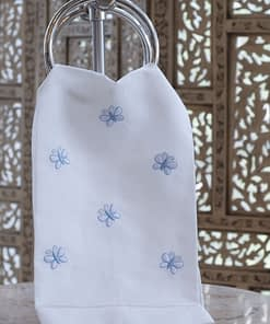 guest towel with blue butterfly embroidery on linen blend