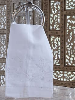 guest towel with hem stitching and flowers embroidered on linen blend