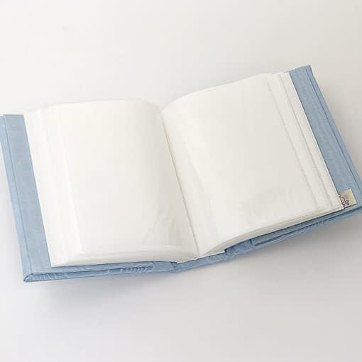 baby photo books by marcella train in blue moire interior