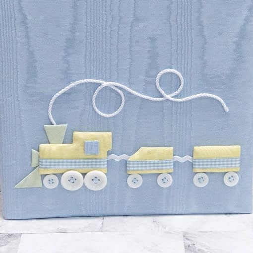 baby memory books by marcella books train in blue moire detail